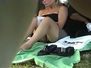 Attractive random blonde milf in the park flashes her panties