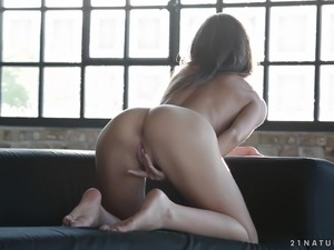 Luscious beauty spreads her legs to masturbate