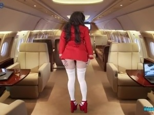 Sexy stewardess Georgie starts stripping and flashing tits on board