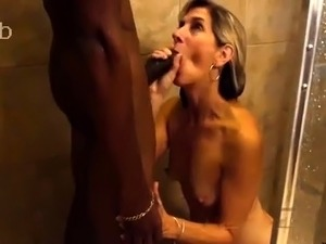 Horny blonde milf gets nailed by a black stud in the shower