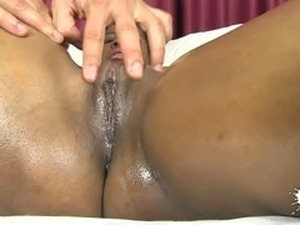 Black oiled up bitch gets her kitty toyed in massage parlor