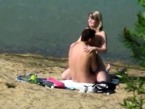 Beach voyeur spies on a young couple having passionate sex