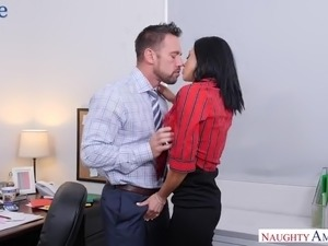 Fabulous tanned busty sexpot in black stuff Audrey Bitoni is fucked at work