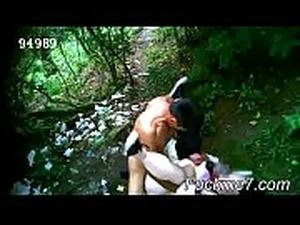 Asian riding a big cock