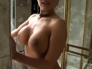 Busty milf delivers a cock-sucking masterpiece in the shower