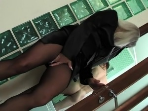 Buxom mature blonde in pantyhose gets fucked by a young stud