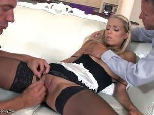 Blonde maid in stockings swallows cum after a double penetration action