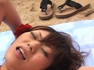 Chick on the beach pleases her man by sucking his pecker