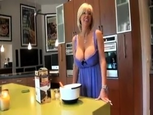 Mature blonde with great bosom gives blowjob in POV