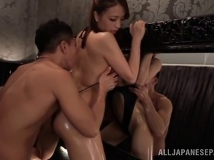 A wild Asian couple gets out the oil and plays hide the cock